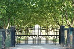Front Gate. Large black metal gate at the entrance to a country estate Royalty Free Stock Photo
