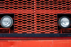 Front of Giant vintage mining truck. Head beam lamps and grill of vinatge giant mining truck Stock Photography