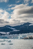 Front of glacier at dusk. Svalbard Royalty Free Stock Images