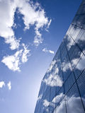 Front glass reflects the sky. Office building in Kaunas reflects the sky Royalty Free Stock Image