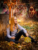 In front of graffiti sitting amongst the leaves. Royalty Free Stock Image