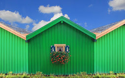 Front of green boat houses with traditional bavarian window Royalty Free Stock Photos