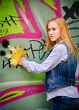 In front of green graffiti. Royalty Free Stock Photography