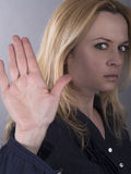 Confident woman showing stop gesture sign with hand Stock Images