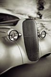 Front Grill of Street Rod. Front grill and headlight view of a restored 1936 chevy classic car done in a quadtone Royalty Free Stock Photos