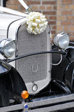 Front Grill of Vintage Wedding Car. With rosette Stock Images