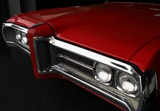 Front grille of red vintage car. Front grille of red vintage american car Royalty Free Stock Photo