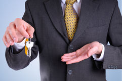 Front half-body commercial agent with keys in hand isolated Stock Image