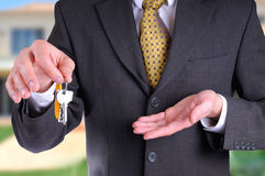 Front half body commercial agent with keys in hand Royalty Free Stock Images