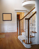 Front hall stairs. With wooden floors and white walls Stock Photos