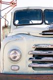 Front headlamp and grill of an old white bedford truck stock images
