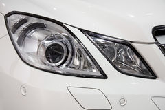 Front headlight. Modern, white, luxury car headlight Royalty Free Stock Image