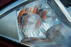 Front headlight. Close-up of parts of a new car Royalty Free Stock Image