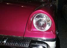 Front headlight crimson retro car royalty free stock photos