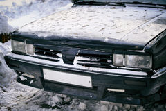 Front headlight of an old car in winter Stock Images