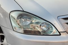 Front headlight view of Toyota Ipsum last generation in silver color after cleaning before sale in a winter day and snow. Novosibirsk, Russia - 03.10.2019: Front royalty free stock photography
