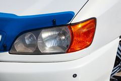 Front headlight view of Toyota Ipsum 1998 year in white color after cleaning before sale on parking. Novosibirsk, Russia - 04.10.2019: Front headlight view of stock image