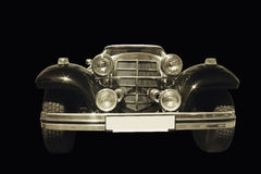 Front headlights and grille of a restored retro car, close up fr Royalty Free Stock Photos