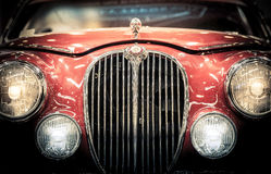 Front headlights and grille of a vintage Jaguar. Stock Photos