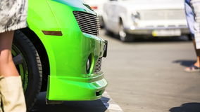Front Hood Of Green Car At Exhibition stock footage