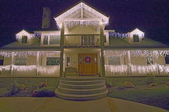 Front of house decorated with holiday lights Royalty Free Stock Photos