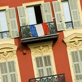 Front of house in Nice. Typical front of house in Nice with french flag on a balcony stock photo