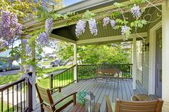 Front house porch with chairs and flowers. Royalty Free Stock Photos