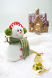 Front house snowman. Snowman with bells standing in front of the house Royalty Free Stock Photo