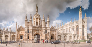 Front King's College Panorama. Cambridge, UK - March 24, 2015: Front View of King's College Chapel Panorama with Pedestrians walking and talking on Street. It's Stock Photo