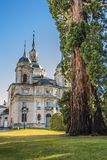 Front of the La Granja palace in vertical format Segovia Spain. Centennial tree and the back facade of the La Granja of San Ildefonso palace Segovia Spain Stock Photography