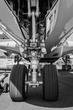 The front landing gear of the aircraft - Airbus A380. BERLIN, GERMANY - MAY 21, 2014: The front landing gear of the aircraft - Airbus A380. Black and White Royalty Free Stock Images