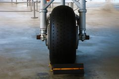 The front landing gear of a small aircraft on the ground stock image