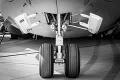The front landing gear of a strategic and tactical airlifter Boeing C-17 Globemaster III. Royalty Free Stock Photography