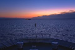Front of a large ferry at dusk. Front of a large passenger ferry sailing between Zante Island and Kyllini town, Greece royalty free stock images