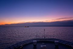 Front of a large ferry at dusk. Front of a large passenger ferry sailing between Zante Island and Kyllini town, Greece royalty free stock photography