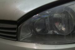 front left headlight of car. crack on top of glass royalty free stock images