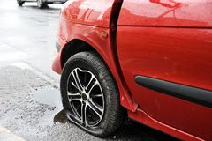 Front left wing and wheel of red car crash accident. On an city road highway Stock Images