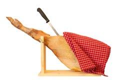 A front leg of a Spanish Serrano ham isolated on white backgroun royalty free stock photo