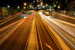 Front light trails. Night traffic in Sydney, photo taken from a pedestrian bridge Stock Photos