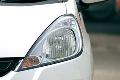 Front light of the white city car Royalty Free Stock Photo