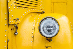 Front lights of yellow school bus in vintage style. Front lights of yellow school bus in vintage style royalty free stock images