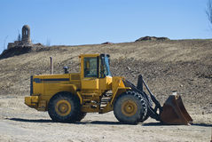 Front loader. A yellow front loader parked Royalty Free Stock Photo
