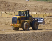 Front Loader. Tractor at Construction Site Stock Photo