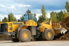 Front loader in action. Heavy front loader in open cast mining quarry Stock Images