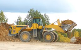 Front loader in action. Heavy front loader in open pit Stock Photo