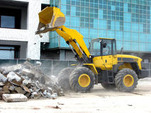 Front Loader Dumping Debris on Construction Site royalty free stock photography