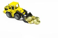 Front loader toy with money Stock Images