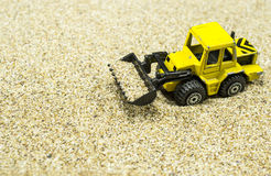 Front loader toy on sand Royalty Free Stock Photo