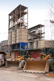 Front loaders and silos in the quarry Stock Images