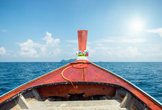 Front longtail boat on blue sea sky. Front longtail boat on blue sea and sky royalty free stock images